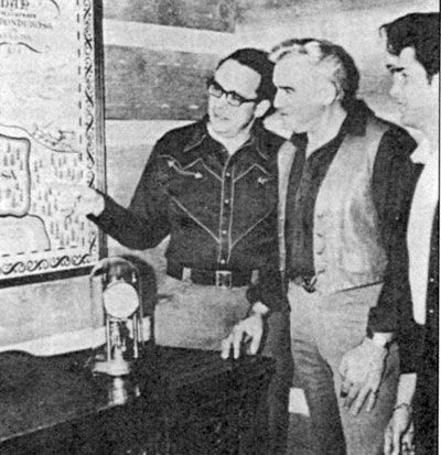 "David Dortort indicates a position on the ""Bonanza"" map to Lorne Greene and Michael Landon."