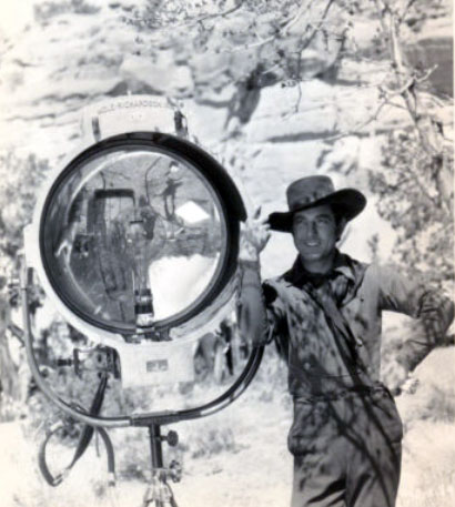 "Johnny Mack Brown stands next to a production light while making ""Billy the Kid"" in 1930. (Thanx to Jerry Whittington.)"