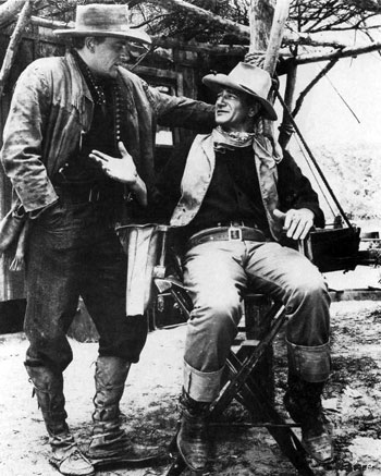 "James Arness and John Wayne talk things over during a break in the making of ""Hondo"". ('53 WB). (Thanx to Jerry Whittington.)"
