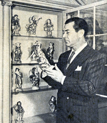 Johnny Mack Brown looks over his household collection of antiques. These are Chelseas, one for each month of the year. Photo taken in early '46.