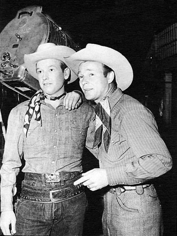 "Roy Rogers welcomes ""The Arizona Cowboy"" Rex Allen to the Republic lot in 1949."