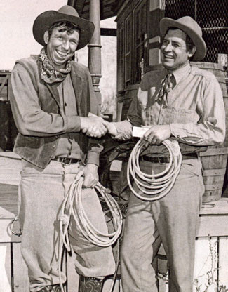 Slim Pickens (left) hands an award to Will Rogers Jr. making him an honorary member of the Rodeo Cowboys Association in 1952.