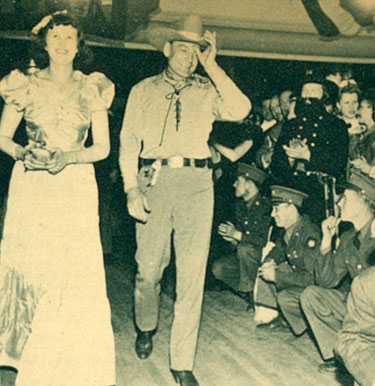 "Buck Jones escorts ?? into the Warner Bros. premiere of ""Virginia City"" in Reno, NV, in 1940."