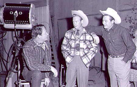 "Rex Allen and Monte Hale visit with Roy Rogers on the set of Republic's ""The Golden Stallion"" ('49)."