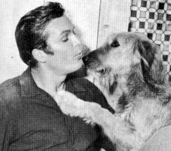 "Circa early '60, Ty (""Bronco"" ) Hardin gets a kiss from his dog Bo."