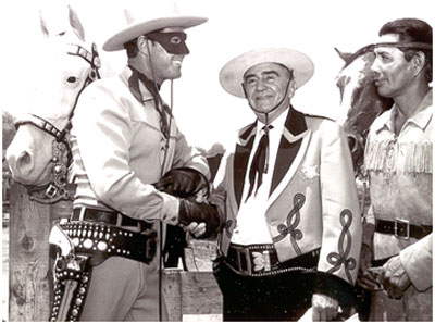 Clayton Moore, Sheriff Eugene Biscailuz, Jay Silverheels at an annual L.A. Sheriff's Rodeo. Note Clayton is wearing the large mask and dark trousers. Silver has no spot in his ear indicating it is the original horse. Also note Clayton's open holster...previously worn by Brace Beemer. (Thanx to Carmen Sacchetti.)