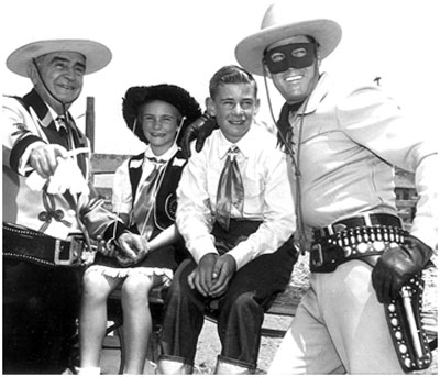 Sheriff Eugene Biscailuz, Joan and William Mohr, Clayton Moore at a Sheriff's Championship Rodeo in L.A. Coliseum.
