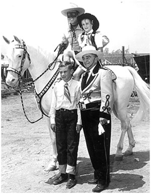 Clayton Moore on the original Silver with Joan and William Mohr, Sheriff Biscailuz at the Sheriff's annual rodeo.