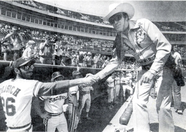 Wearing sunglasses, Clayton Moore appeared at Texas Rangers games for several years.