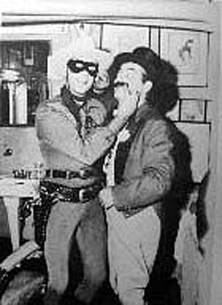 "Clayton Moore as the Lone Ranger clowns around with ringmaster Jerry Colonna on TV's ""Super Circus"" on February 12, 1956."