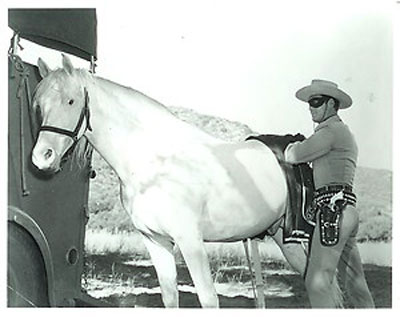 The Lone Ranger prepares to saddle Silver.