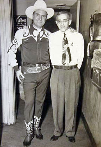 Gene poses with an unknown theatre owner. (Thanx to Jerry Whittington.)