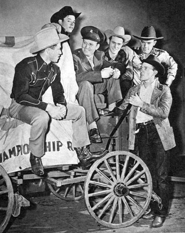 One year, during Gene's time in the service, he was granted a ten day furlough and spent it in New York at the Madison Square Gardens rodeo which that year starred Roy Rogers. Here Sgt. Autry talks with a group of the Garden cowboys.