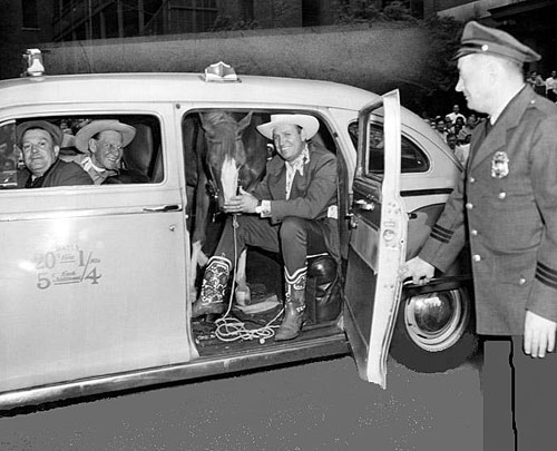 Gene and Champ arrive by cab for a rodeo performance. (Thanx to Jerry Whittington.)