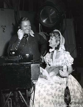 "Publicity shot of Gene and Gail Davis during the making of  ""Goldtown Ghost Riders"" ('53)."