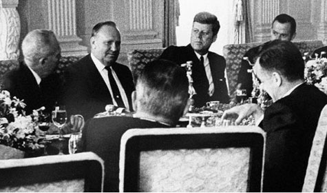 Gene sits with President Kennedy for an unknown event.