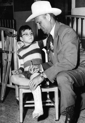 Gene signs a boy's cast at the Shriner's Hospital in 1958. (Thanx to Jerry Whittington.)