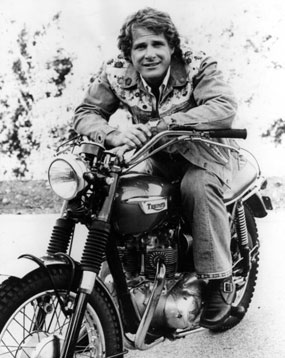 "Ben Murphy of ""Alias Smith and Jones"" on his Triumph motorcycle in 1977. (Thanx to Terry Cutts.)"