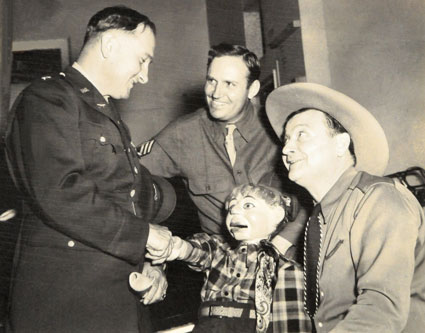 T/Sgt. Gene Autry introduces his friends Max Terhune and Elmer to one of Gene's officers in 1942.