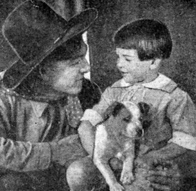 Harry Carey tells a young boy a wild west story in 1920.