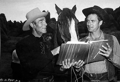 "Randolph Scott and Jocko Mahoney check over the script for ""The Doolins of Oklahoma"" ( '49 Columbia). (Thanx to Bobby Copeland.)"