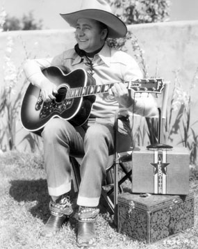 Rehearsing on the range—Tex Ritter.