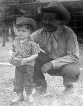 Tim Holt in 1949 with a young Mike Shoulders, son of Marvin Shoulders who was the brother of rodeo star Jim Shoulders.