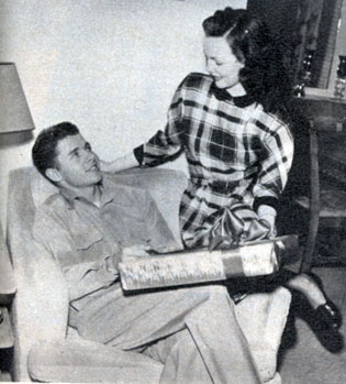 Christmas, 1948. Wanda Hendrix presents Audie Murphy's Christmas gift. The couple were married on February 8, 1949.