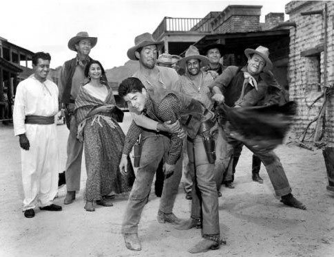 "Dean Martin, John Wayne and others celebrate Ricky Nelson's 19th birthday on the set of ""Rio Bravo"" in 1959."