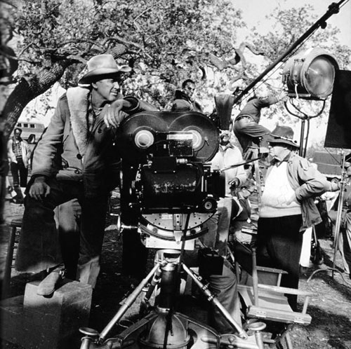 "James Stewart and director John Ford await the next scene setup on ""Two Rode Together"" ('61). (Thanx to Jerry Whittington.)"