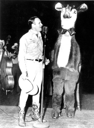 "Gene Autry and a ""real live"" Rudolph the Red-Nosed Reindeer."