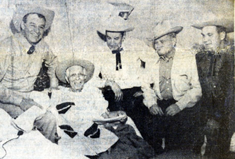 On December 24, 1960, several longtime friends of Hoot Gibson came to wish him a Merry Christmas at Southern Nevada Memorial Hospital where Gibson was recovering from an ailment. (L-R) Lt. Gov. Rex Bell, Hoot, Constable Woody Cole, Woody Woodward and Sid Freedman.