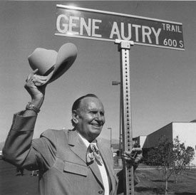 Gene Autry waves from in front of Gene Autry Trail, dedicated in Palm Springs, CA, in 1984.