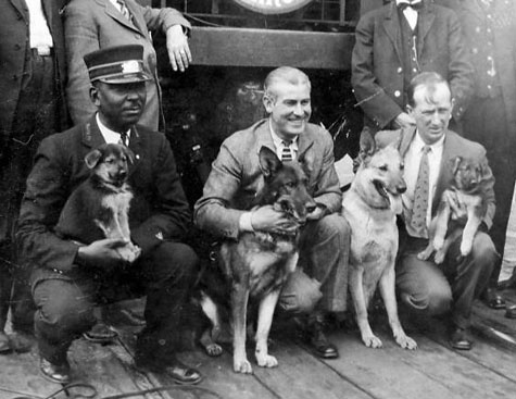 Dog owner Lee Duncan and Rin Tin Tin (center) at the Alvarado Hotel in Albuquerque, NM, circa 1925.