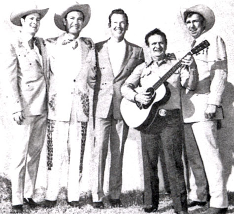 Western wear tailor Nudie with (L-R) Casey Tibbs, Tex Williams, Rex Allen and Slim Pickens.