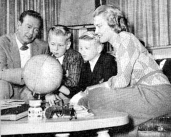 "The ""Frontier Doctor"" Rex Allen and wife Bonnie have a geography session with sons Rex Jr. (Chico) and Curtis in mid-1959. The couple were married in '46 but later divorced."