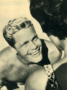 "Trampas of ""The Virginian"", Doug McClure, emerges from the swimming pool to greet a fan."