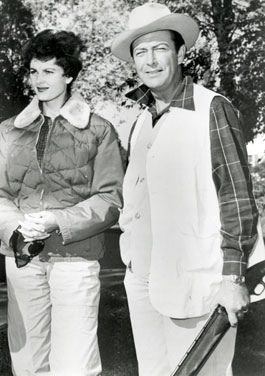 Robert Taylor with his wife actress Ursula Thiess on a hunting trip at Nilo Farms in Brighton, IL. Taylor was named honorary director of the '67 Winchester Claybird Tournament.