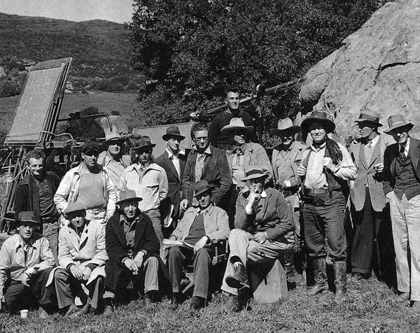 "Bob Livingston, Bob Steele and Rufe Davis (The Three Mesquiteers) pose with the crew of ""Saddlemates"" ('41 Republic). Director Les Orlebeck is seated in the front row with the script in his lap. (Thanx to Bobby Copeland.)"