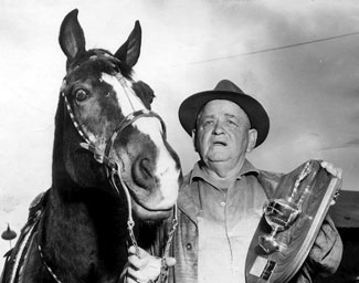 Fat Jones Stables was one of the major suppliers of horses to movies. This is Fat with a horse named Baldy. (Thanx to Kenneth Kitchen.)