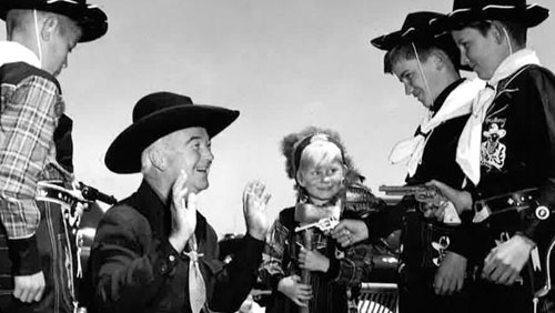 Hopalong Cassidy ambushed by Aussies! Hoppy was appearing at the Estcourt House, Grange, a coastal suburb of Adelaide, Australia. Estcourt House was a convalescent home for children.