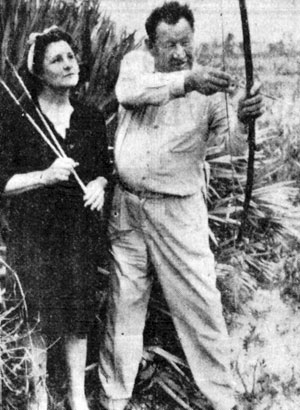 Famous Indian sports figure and actor Jim Thorpe with his wife Patricia practicing with bow and arrow in Miami, Florida, in January 1946.