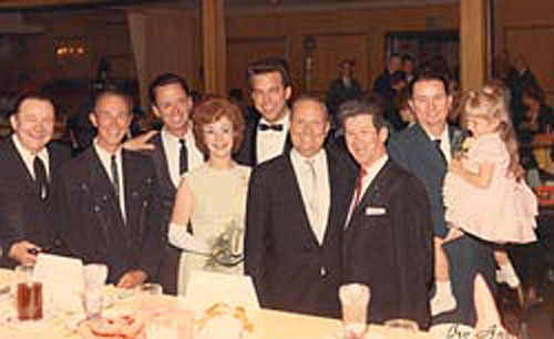 A nice gathering for Tex Ritter and Dorothy Fay's 25th wedding anniversary celebration in 1966. (L-R) Tex Ritter, Eddie Dean, Joe and Rose Lee Maphis, unknown, Gene Autry, Roy Acuff, Johnny Bond and Heather Moore.