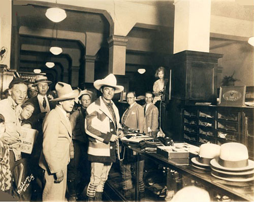 Art Acord and Tom Mix do a little shopping at an Oklahoma City men's store in the '20s. (Thanx to Jerry Whittington.)