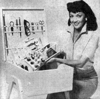 Mari Blanchard demontrates a handy chest for holding sewing articles. When closed it serves as a small seat.