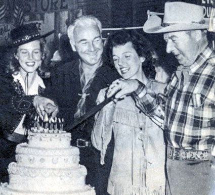 "Celebrating 50 Hopalong Cassidy features in 1943 are Barbara Britton, William Boyd, Jane Wyatt and Harry ""Pop"" Sherman."