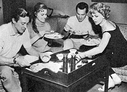 "Pat Conway (center) of ""Tombstone Territory"" cooked up a great meal for his guests Britt Lomond of ""Zorro"", Lomond's fiancee Diane Tutini and actress Pamela Duncan. (June '59)."