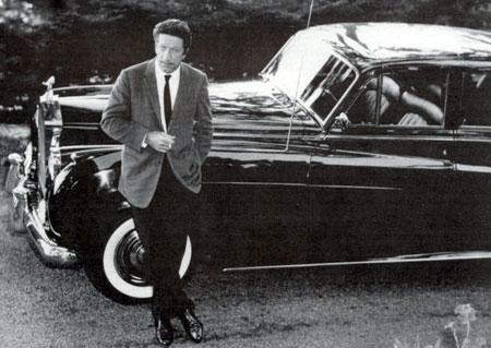 "Richard Boone leans against the Rolls Royce John Wayne gave him for playing Sam Houston in ""The Alamo"" ('60)."