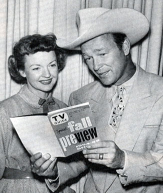 Roy Rogers and Dale Evans check out their TV series listings in the 1954 Fall preview edition of TV GUIDE.