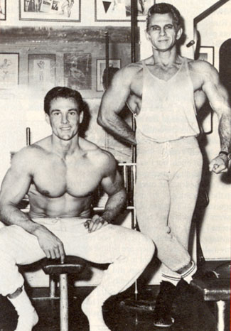 "6 ft. 2 in., 218 lb. William Smith (""Laredo"") at Vince's Gym with the Iron Guru Vince Gironda."